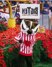 Bucky Badger in front of a parade float