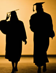 Graduating students in silhouette